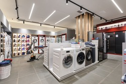 Washing machines and vacuum cleaners in the premium home appliance store