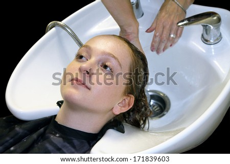 Washing of a head at the hair dresser