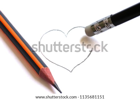 Washing on pencil erases the painted heart. Simple pencils symbolize ruined love #1135681151