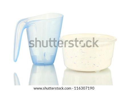 washing powder in a measuring cups, isolated on white