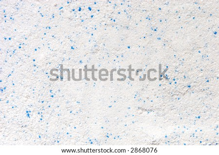 Washing powder texture with blue disseminations.