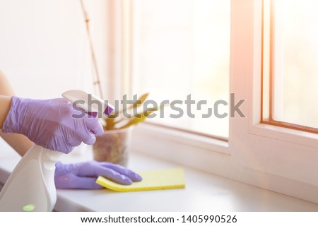 Washing windows in living room. cleaning company for cleaning residential houses and apartments. - Image   #1405990526