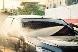 Washing with pressure gun my new black car