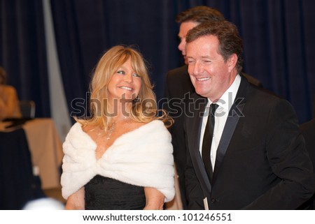 WASHINGTON - APRIL 28: Goldie Hawn and Piers Morgan arrive at the White House Correspondents Dinner April 28, 2012 in Washington, DC