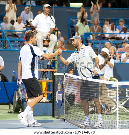 WASHINGTON - AUG 1: James Blake (USA) shakes hands with Marco Chiudinelli (SUI) after Blake took the match at the Citi Open tennis tournament on August 1, 2012 in Washington.
