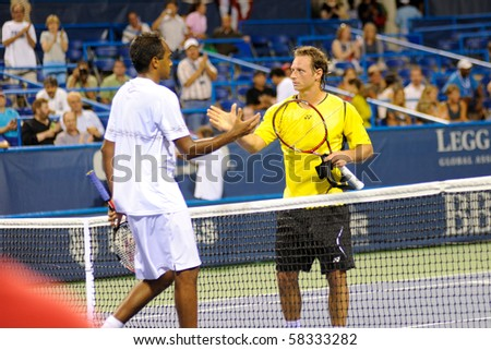 WASHINGTON - AUGUST 2: David Nalbandian (ARG) and Rajeev Ram (USA) after their first round match at the Legg Mason Tennis Classic on August 2, 2010 in Washington.  Nalbandian defeated Ram.