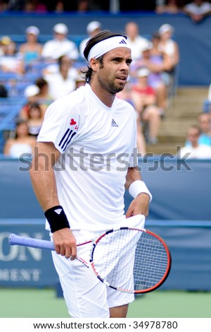 WASHINGTON - AUGUST 8: Fernando Gonzalez (CHI) takes a breather at the Legg Mason Tennis Classic semifinals on August 8, 2009 in Washington. Gonzalez was defeated by Juan Martin Del Potro (ARG).