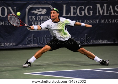WASHINGTON - AUGUST 6: Lleyton Hewitt (AUS) reaches for the ball at the Legg Mason Tennis Classic on August 6, 2009 in Washington. Hewitt was defeated by Juan Martin Del Potro (ARG).