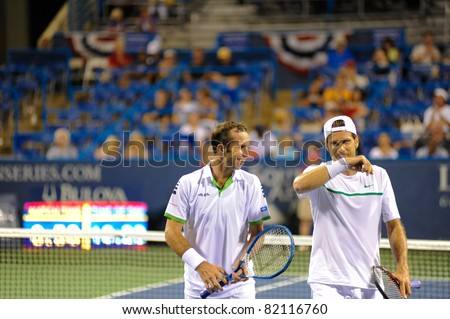 WASHINGTON - AUGUST 1:  Max Mirnyi (BLR) and Daniel Nestor (CAN) are defeated by Tommy Haas (GER) and Radek Stepanek (CZE) at the Legg Mason Tennis Classic on August 1, 2011 in Washington.