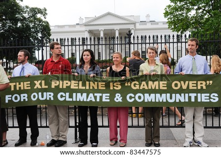 WASHINGTON - AUGUST 25: Protesters of the Keystone XL Pipeline hold a banner in front of the White House before the sixth day of arrests on August 25, 2011 in Washington.