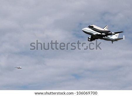 WASHINGTON, D.C. - APRIL 17: Space Shuttle Discovery on top of a Boeing 747, escorted by a Northrop T-38 chase plane, en route to Dulles Airport in Washington D.C. on April 17, 2012.