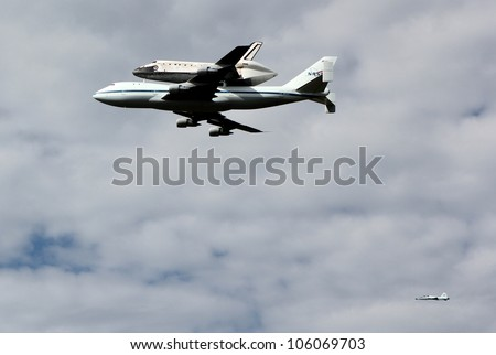 WASHINGTON, D.C.- APRIL 17: Space Shuttle Discovery on top of a Boeing 747, escorted by a Northrop T-38 chase plane, en route to Dulles Airport in Washington D.C. on April 17, 2012.