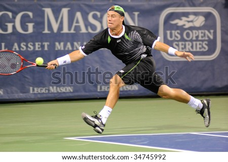 WASHINGTON, D.C. - AUGUST 3: Lleyton Hewitt (AUS) defeats Donald Young (USA) at the Legg Mason Tennis Classic on August 3, 2009 in Washington D.C. - stock photo