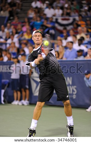 WASHINGTON, D.C. - AUGUST 3: Lleyton Hewitt (AUS) defeats Donald Young (USA) at the Legg Mason Tennis Classic on August 3, 2009 in Washington D.C.