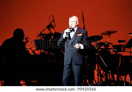 WASHINGTON, D.C. - JULY 21: Frank Sinatra sings to a sellout crowd at the Warner Theater in Washington, D.C. Backing Sinatra was the Nelson Riddle Orchestra on July 21, 1991 in Washington DC - stock photo