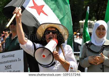 WASHINGTON D.C - JUNE 30: Unidentified Syrians in front of White House protesting for Syrian freedom on June 30, 2011 in Washington D.C, USA.