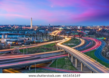Washington, D.C. skyline with highways and monuments.