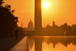 Washington D.C. - Sunrise at Lincoln Memorial with silhouettes of Capitol Building and Washington Monument