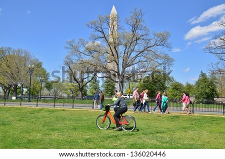 WASHINGTON, DC - APRIL 13: Cherry Blossom Festival on April 13, 2013 in Washington DC,USA. The festival is a spring celebration in Washington, D.C.and people from all over the world come to visit. - Shutterstock ID 136020446