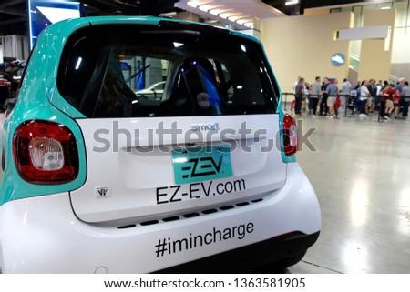 WASHINGTON, DC - APRIL 7, 2019: SMART CAR with EZ-EV.COM decal at Washington Auto Show #1363581905