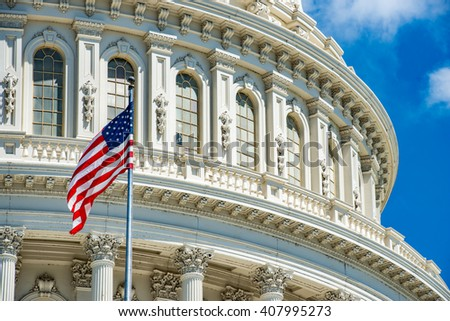 Washington DC Capitol dome detail with waving americanstar and stripes flag