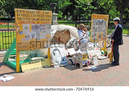 WASHINGTON DC - CIRCA JULY 2009: Protesting woman against nuclear weapon in front of White house circa July 2009 in Washington DC, USA.