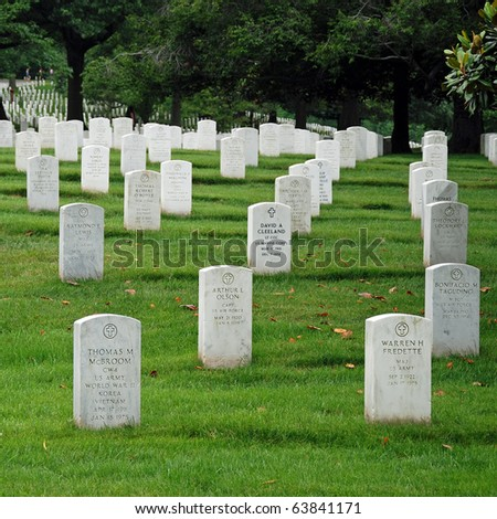 WASHINGTON DC - CIRCA JUNE 2009: Gravestones on Arlington National Cemetery circa June 2009 in Washington DC, USA. Headstones mark soldier graves who died in every conflict from Revolution to Sept 11.