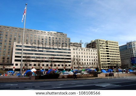 WASHINGTON, DC - DECEMBER 30: Occupy Wall Street protesters camp out in Freedom Plaza on December 30, 2011 in Washington, DC. Police cleared the tents from the square on February 5, 2012. - stock photo