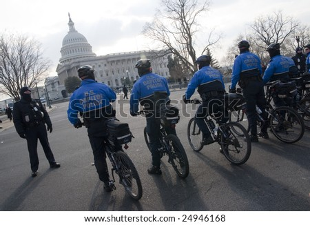 WASHINGTON, DC - JAN. 20: A formation of U.S. Capitol Police on bicycles guard the parade route of newly inaugurated President Barack Obama in 2009.