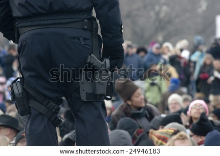 WASHINGTON, DC - JAN. 20: A policeman stands guard over a crowd on the National Mall during the 2009 inauguration of Barack Obama.