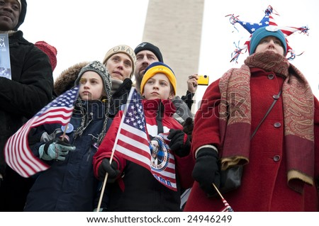 WASHINGTON, DC - JAN. 18: Crowds of  supporters near the Washington Monument celebrate the 2009 inauguration of Barack Obama.