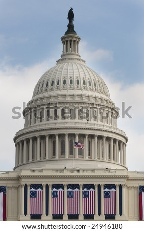 WASHINGTON, DC - JAN. 20: The dome of the United States Capitol Building decorated with historic flags for the 2009 inauguration of President Barack Obama.