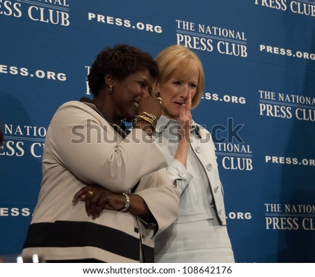 WASHINGTON, DC - JULY 24:  PBS newscasters and anchors Gwen Ifill and Judy Woodruff share a private comment after their speeches at the National Press Club, July 24, 2012 in Washington, DC