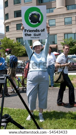 WASHINGTON, DC - June 4: Older female demonstrator holds up sign in protest against BP oil spill, June 4, 2010 in Washington, DC