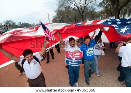 WASHINGTON, DC - MARCH 21: A giant American flag is carried among some 200,000 immigrants' rights activists flood the National Mall on March 21, 2010 in Washington DC.