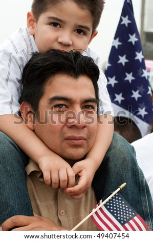 WASHINGTON, DC - MARCH 21: Daniel Rogel and son Daniel Rogel Jr. (4) of Silver Spring MD stand with some 200,000 immigrants' rights activists on the National Mall on March 21, 2010 in Washington, DC.