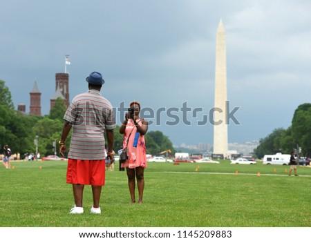 Washington, DC - May 31, 2018: People at National Mall and Washington Monument at the background in Washington DC, USA