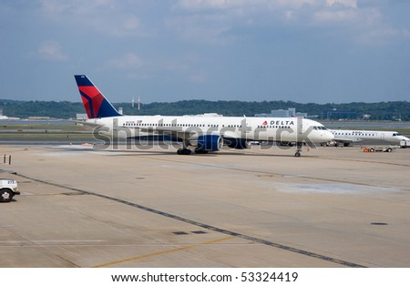 WASHINGTON, DC - MAY 5: U.S. regulators are demanding that Delta Airlines auction off slots at Reagan Airport, to create openings for other airlines. A Delta aircraft on May 5, 2010 in Washington, DC.