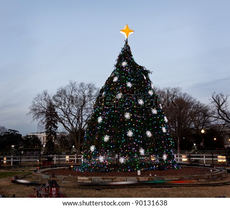 Washington DC national christmas tree with white house in the distance
