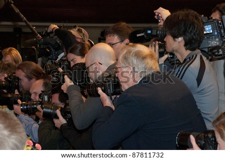 WASHINGTON, DC - OCTOBER 31: Photographers fight for position before a speech by Herman Cain at the National Press Club, October 31, 2011 in Washington, DC