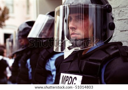 WASHINGTON, DC - SEPT 27: Police in full riot gear and batons guard Gap stores during anti-sweatshop protests in Washington, DC on Sept. 27, 2002.