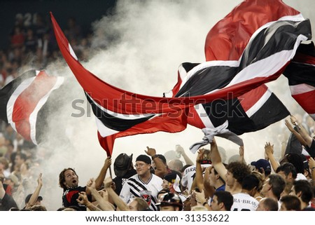 WASHINGTON, DC - SEPTEMBER 9:  DC United supporters celebrate a goal during a Major League Soccer match against Real Salt Lake at RFK Stadium in Washington, DC September 9, 2006.