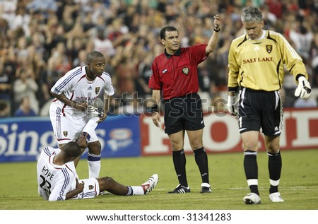 WASHINGTON, DC - SEPTEMBER 9:  The referee calls for assistance as Real Salt Lake's Eddie Pope (23) suffers from leg cramps during a soccer match against DC United in Washington, DC September 9, 2006.