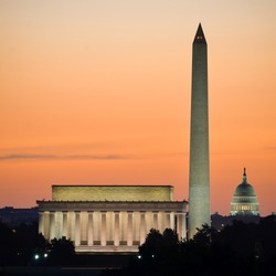 Washington DC skyline at sunrise including Lincoln Memorial, Washington Monument and United States Capitol building