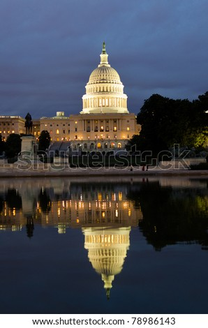 Washington DC - US Capitol building and its reflection on pool - stock photo