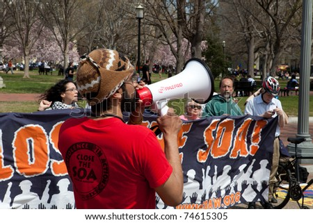 WASHINGTON, DC, USA - APRIL 4: Protesters demand closure of the Western Hemisphere Institute for Security Cooperation, formerly the School of the Americas. April 4, 2011 in Washington, DC, USA