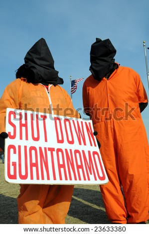 WASHINGTON - JAN 20: Hooded demonstrators demand the closing of Guantanamo during the inauguration of U.S. President Barack Obama on January 20, 2009 in Washington.