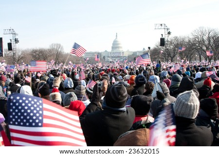 WASHINGTON - JANUARY 20: People marching towards the US Capitol building where President-elect Barack Obam will be inaugurated on January 20, 2009 in Washington.