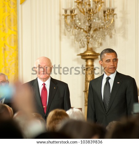 WASHINGTON - MAY 29: Former astronaut and U.S. Senator John Glenn (L) waits to receive the Presidential Medal of Freedom at a ceremony at the White House May 29, 2012 in Washington, D.C.