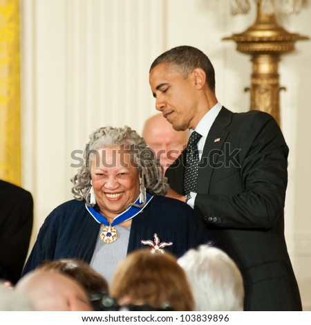 WASHINGTON - MAY 29: Novelist Toni Morrison smiles as she receives the Presidential Medal of Freedom at a ceremony at the White House May 29, 2012 in Washington, D.C. - stock photo